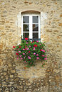 Colorful Flowers in Window of Ancient Building Stock Photo