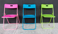 Colorful folding chair simply beautiful blue pink and green with black background Stock Photo