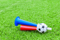 Colorful football hooter on green grass Stock Photo