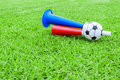Colorful football hooter on green grass Stock Images