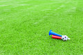 Colorful football hooter on green grass Royalty Free Stock Image