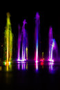 Colorful fountain full of colors at night Stock Photography