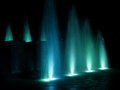 Colorful fountain at night turquoise stock photo water on dark background Royalty Free Stock Photos
