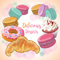 Colorful french macaroons, croissant, cupcake, donut.