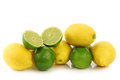 Colorful fresh lime and lemon fruit a cut one on a white background Stock Image