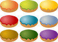 Colorful frosted icing donuts Stock Images