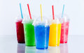 Colorful Frozen Fruit Slush Drinks in Plastic Cups Royalty Free Stock Photo
