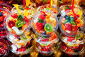 Colorful fruit salad in transparent glasses Royalty Free Stock Photos