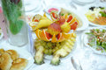 Colorful fruits decorated festive table Stock Photos
