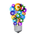 Colorful gear turning light bulb Royalty Free Stock Photography
