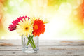 Colorful gerbera flowers on wooden table Royalty Free Stock Photo