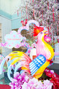 Colorful giant rooster and red Chinese lanterns Royalty Free Stock Photo