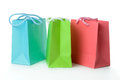 Colorful gift bags red green and blue on white background Stock Images