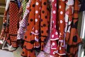 Colorful gipsy flamenco dresses on rack hanged in Spain market