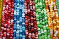Colorful glass beads on the counter Royalty Free Stock Photo