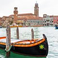 Colorful gondola boat at the water, venetian houses and canal view Royalty Free Stock Photo