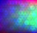 Colorful gradient hexagonal background in bright rainbow colors. Abstract blurred image.