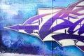 Colorful graffiti on a brick wall