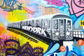 Colorful graffiti in New York City with an image of a subway tra Royalty Free Stock Photo