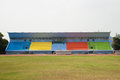 Colorful grandstand in football stadium Royalty Free Stock Image