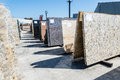 Colorful granite slabs for sale in store yard Stock Images