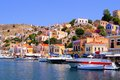 Colorful greek islands harbor with boats at symi greece Stock Photography