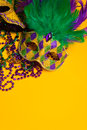 Colorful group of mardi gras or venetian masks a festive carnivale on a yellow background Royalty Free Stock Photos