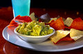 Colorful guacamole and chips Stock Photography