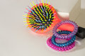 Colorful hairbrush with holders for hair Royalty Free Stock Photo
