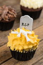 Colorful halloween cupcakes on a rustic wooden table three variation of close up Stock Photo