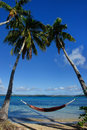 Colorful hammock between palm trees ofu island vavau group to tonga Stock Photos