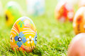 Colorful hand painted Easter eggs in grass. Spring theme