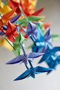 Colorful handmade origami cranes or fantasy birds Royalty Free Stock Photo