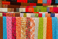 Colorful handmade shawls in loas market Stock Photos