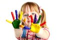Colorful hands girl having fun her face and palms covered with paint Royalty Free Stock Photography