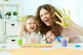Colorful hands portrait of a happy family having fun painting with palms and fingers Royalty Free Stock Photography