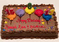 Colorful Happy Birthday chocolate cake with age candles Royalty Free Stock Photo