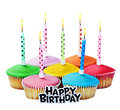Colorful happy birthday cupcakes with candles Royalty Free Stock Photo