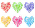 Colorful heart shapes made by flowers in white background Royalty Free Stock Image