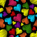 Colorful hearts on black background. Royalty Free Stock Images