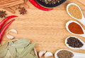 Colorful herbs and spices selection aromatic ingredients on cutting board with copyspace Stock Photo