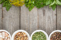 Colorful herbs and spices selection aromatic ingredients on wood table with copyspace Royalty Free Stock Photography