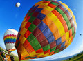 Colorful hot air balloon laid flat on the surface, making ready Royalty Free Stock Photo
