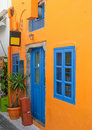 Colorful house with blue windows in Santorini Stock Image