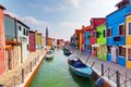 Colorful houses and canal on burano island near venice italy sunny day Stock Image