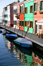 Colorful houses in front of a canal in burano view with Royalty Free Stock Photography