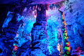 Colorful illuminated cave stalactites with different colors a in guilin china Royalty Free Stock Photo