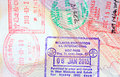 Colorful immigration arrival stamps on passport