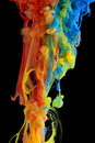 Colorful ink swirling through water Royalty Free Stock Photo