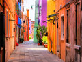 Colorful italian street in burano near venice italy Stock Photos
